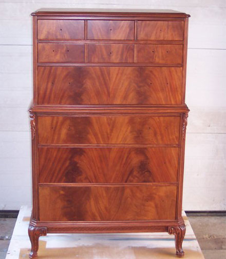 Surprise! This is the same mans dresser, stripped and refinished. The wood is a book matched flamed mahogany. Gorgeous!