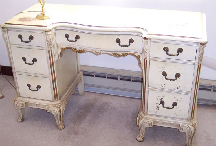Vanity painted white with gold details