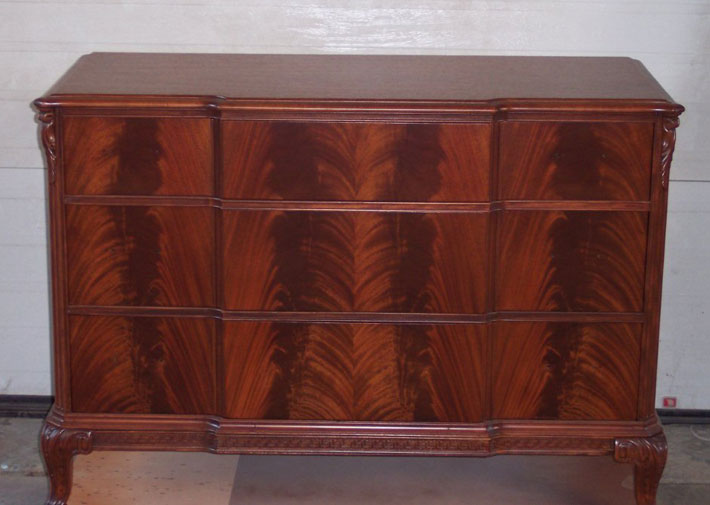 Surprise! This is the ladies dresser, stripped and refinished. The wood is a book matched flamed mahogany. Gorgeous!