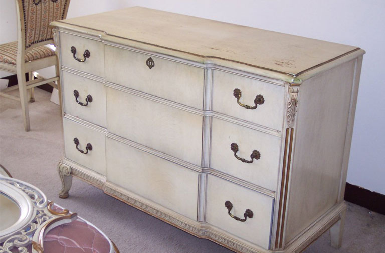 Ladies' dresser painted white with gold details.