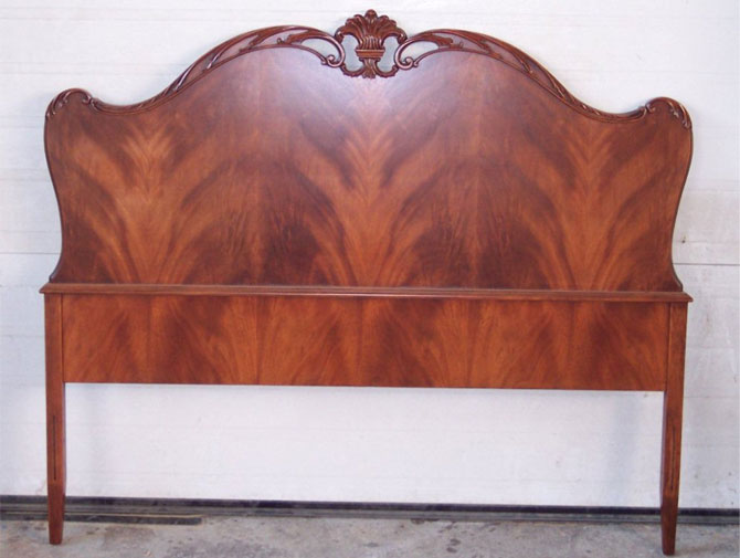 Surprise! This is the same headboard, stripped and refinished. The wood is a book matched flamed mahogany. Gorgeous!