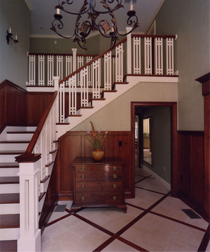 New Arts & Crafts staircase: Stained in a warm red-brown and finished in a low lustre sheen.