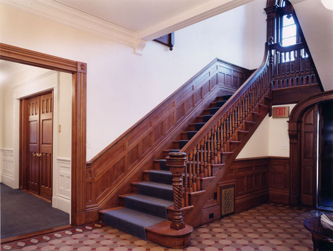 Boston College: Quartered oak staircase and vesitbule. The old and badly worn finish was stripped away and the oak was finished in the beautiful finish you see now.