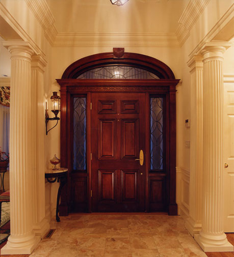 Custom made Spanish cedar door and entry, finished to compliment the hallway colors.
