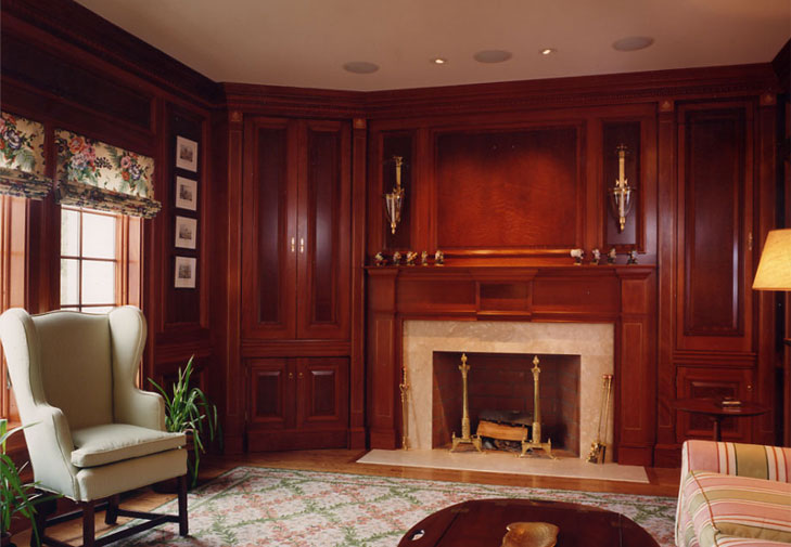 Mahogany and sapeli wood accented panels, finished in a closed grained, high polish finish.