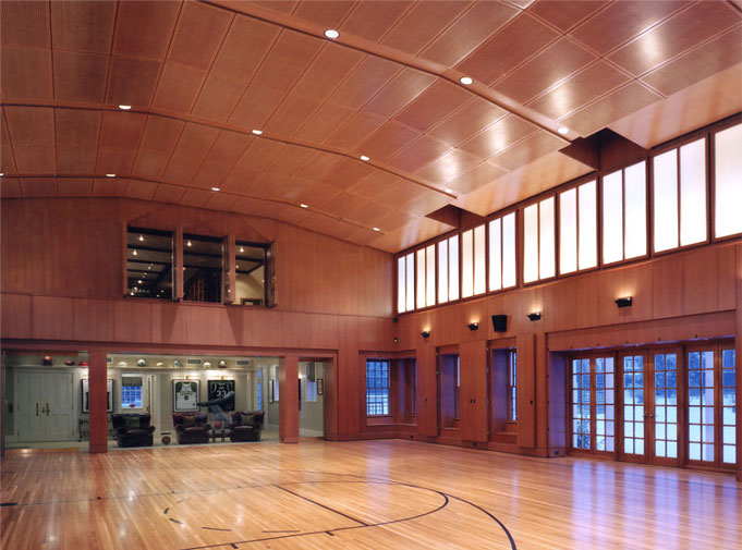 Rift-sawn oak paneling & ceiling in private basket ball court.