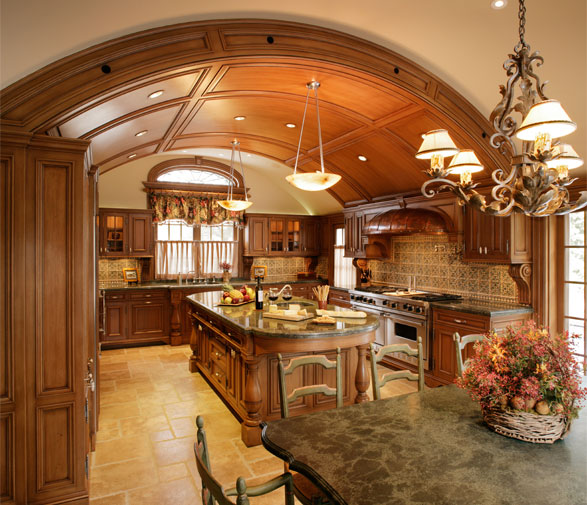 The kitchen, with a barrel-vaulted ceiling, is milled in quartered white oak which was stained and then finished using multiple glazes, creating an old world feel.