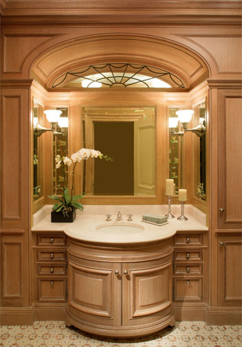 The powder room woodwork is quarter white oak with a ceruse finish.