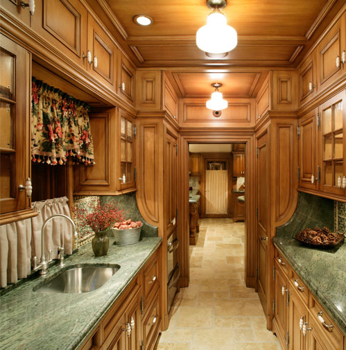 The butler's pantry is quartered white oak which was stained and then finished using multiple glazes, creating an old world feel.