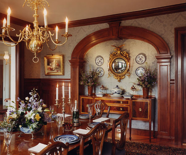 The woodwork in this room is European sycamore and had been painted. We stripped away years of paint, restoring it to it's original clear finish. The arch over the server is new American sycamore and was color matched to the rest of the wood.