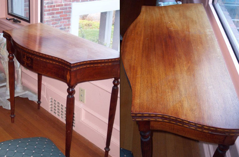 Antique mahogany card table with a sun damaged finish.